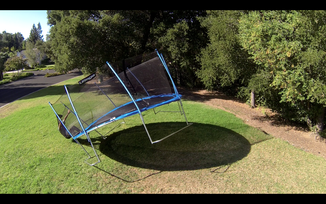 Guy-jumping-into-safety-net-tipping-over-outside-trampoline