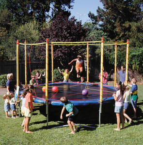 the first trampoline safety enclosure outside kids jumping
